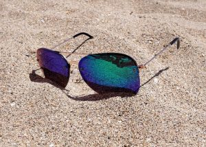 holidays - sunglases on the beach