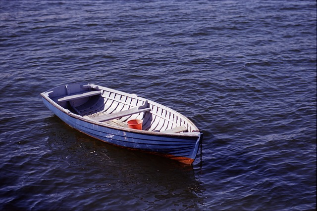 Empty blue rowing boat on an empty sea.  Soothing picture butjumping ship too early may result in forfeiture of entitlement to redundancy pay.
