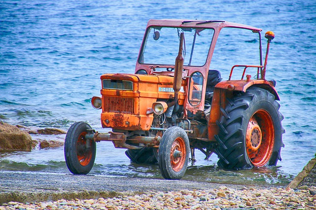 driverless tractor at the edge of the seaver